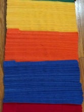 "Load image into Gallery viewer, Stacks of 25 pieces of 10"" red, blue, orange and yellow grap is pictured. grap is double-sided hook and loop used to craft, organize, and problem-solve in the home, garage, rv, boat, and craft room!"