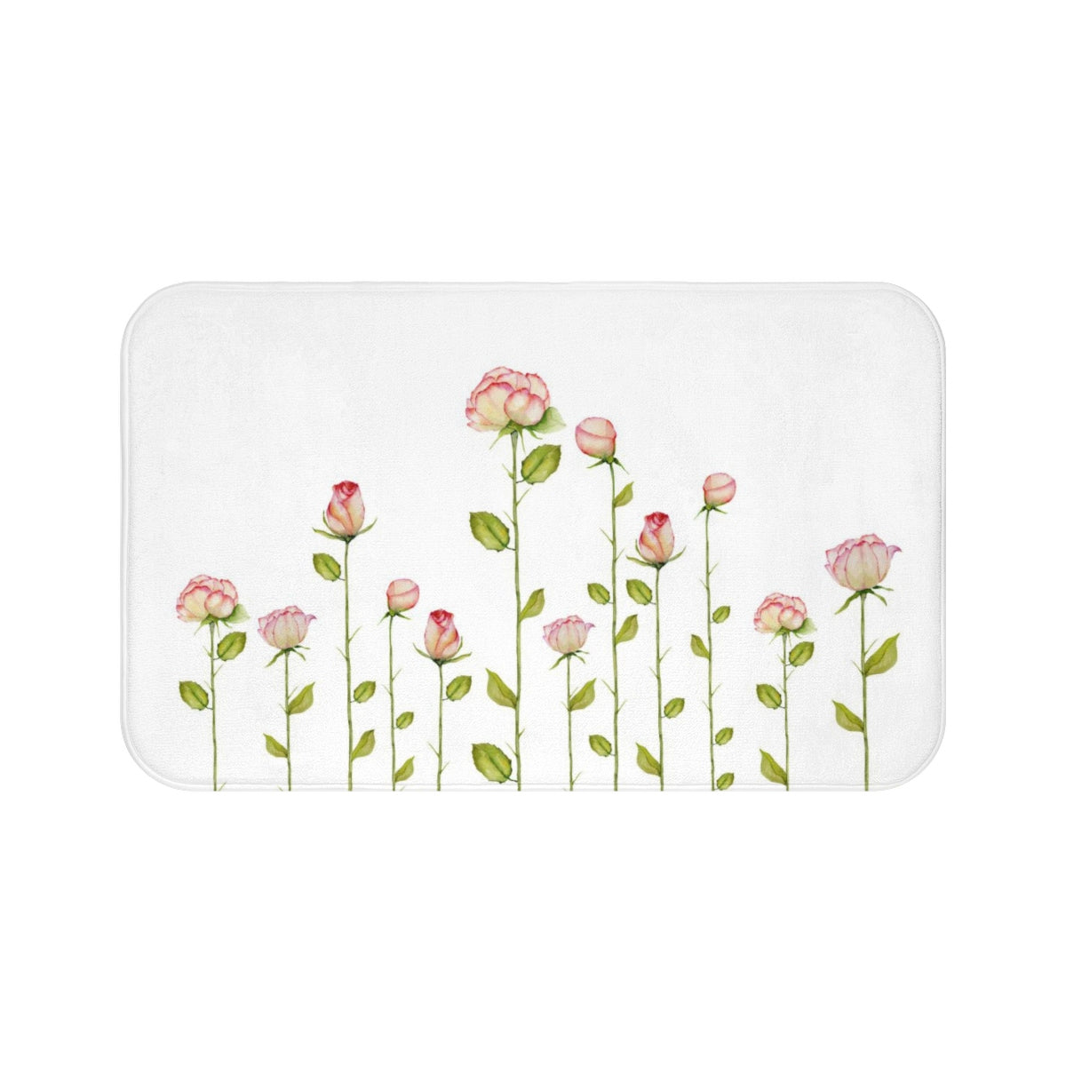 white bath mat with a print of pink roses
