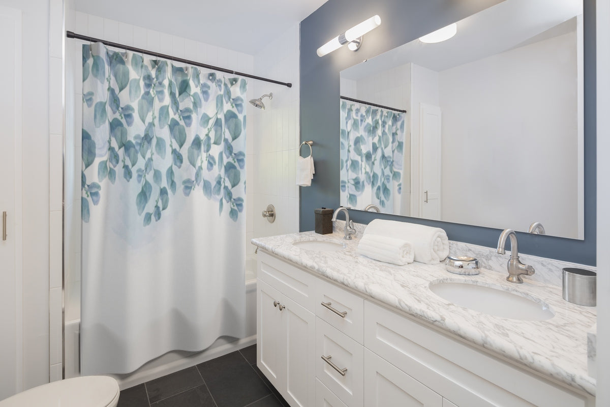 printed shower curtain with blue leaves on a white background
