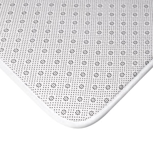 Corner of black and white backing of bath mat
