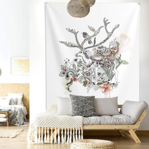 Deer wall tapestry, hanged above sofa in a boho living room