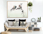 love bird art, hanged above modern sofa with pillows