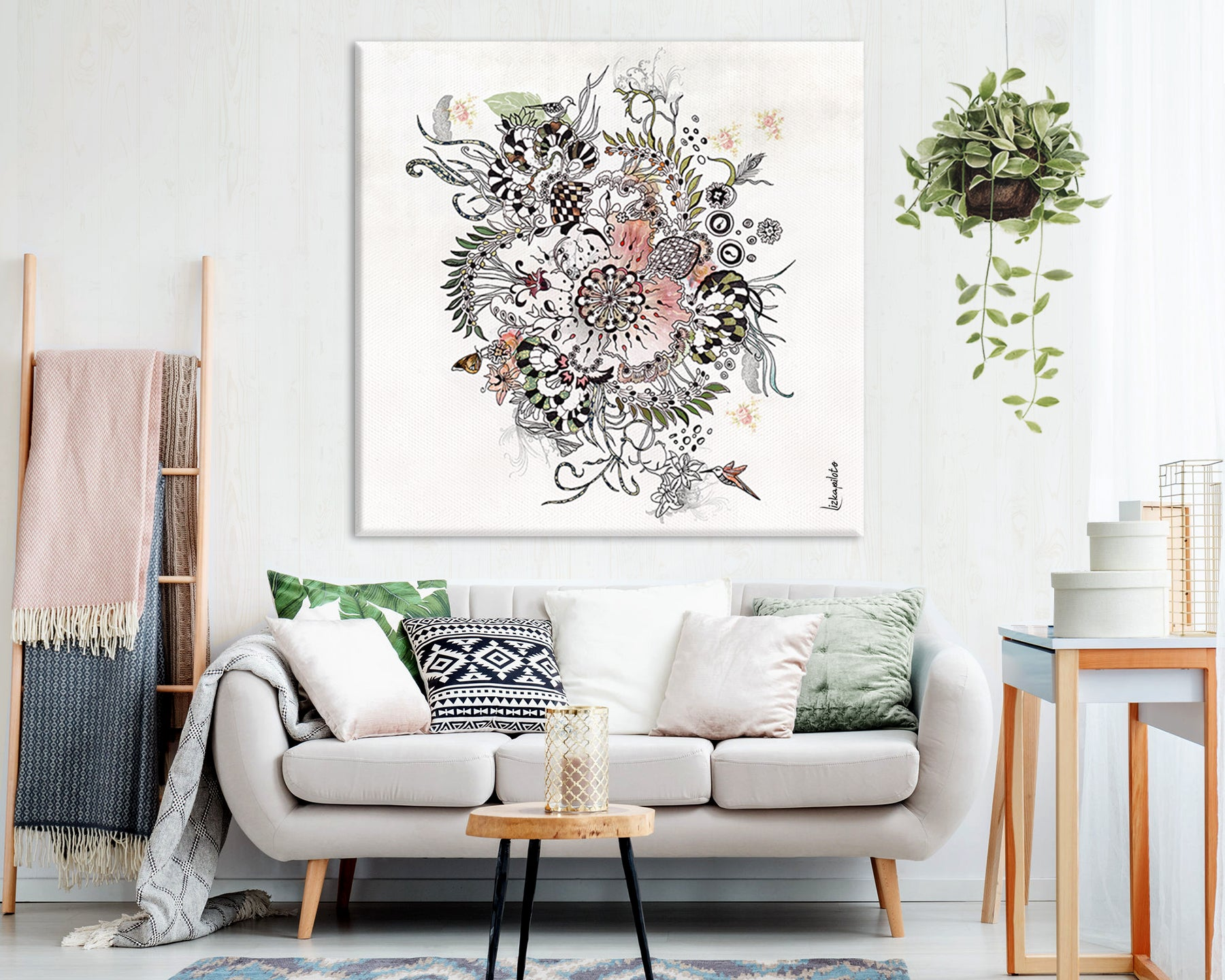 Large canvas with mandala painting in a modern living room above sofa with pillows