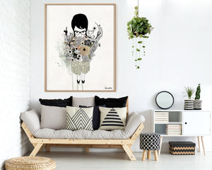 Girl with a large bouquet painting, framed and hanged above couch with pillows