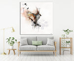 Flying bird art, hanged on a white wall, above a gray sofa
