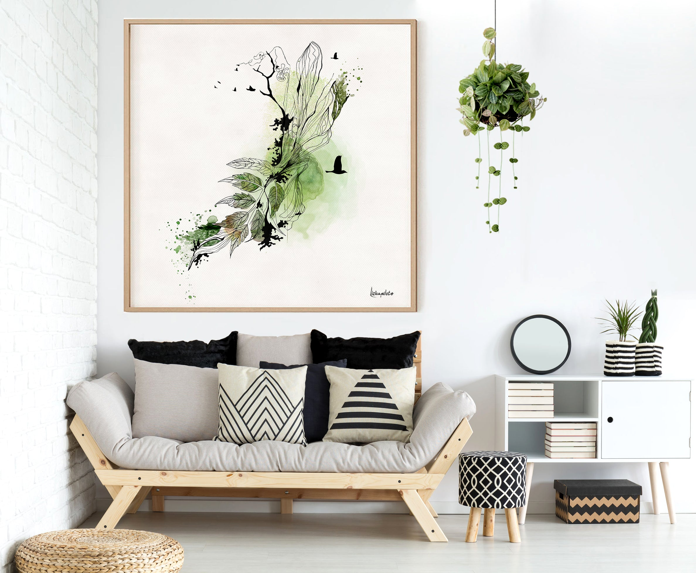 Green and black painting on a white wall in living room