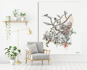 Large deer wall art on canvas, hanged on a white wall above a gray couch