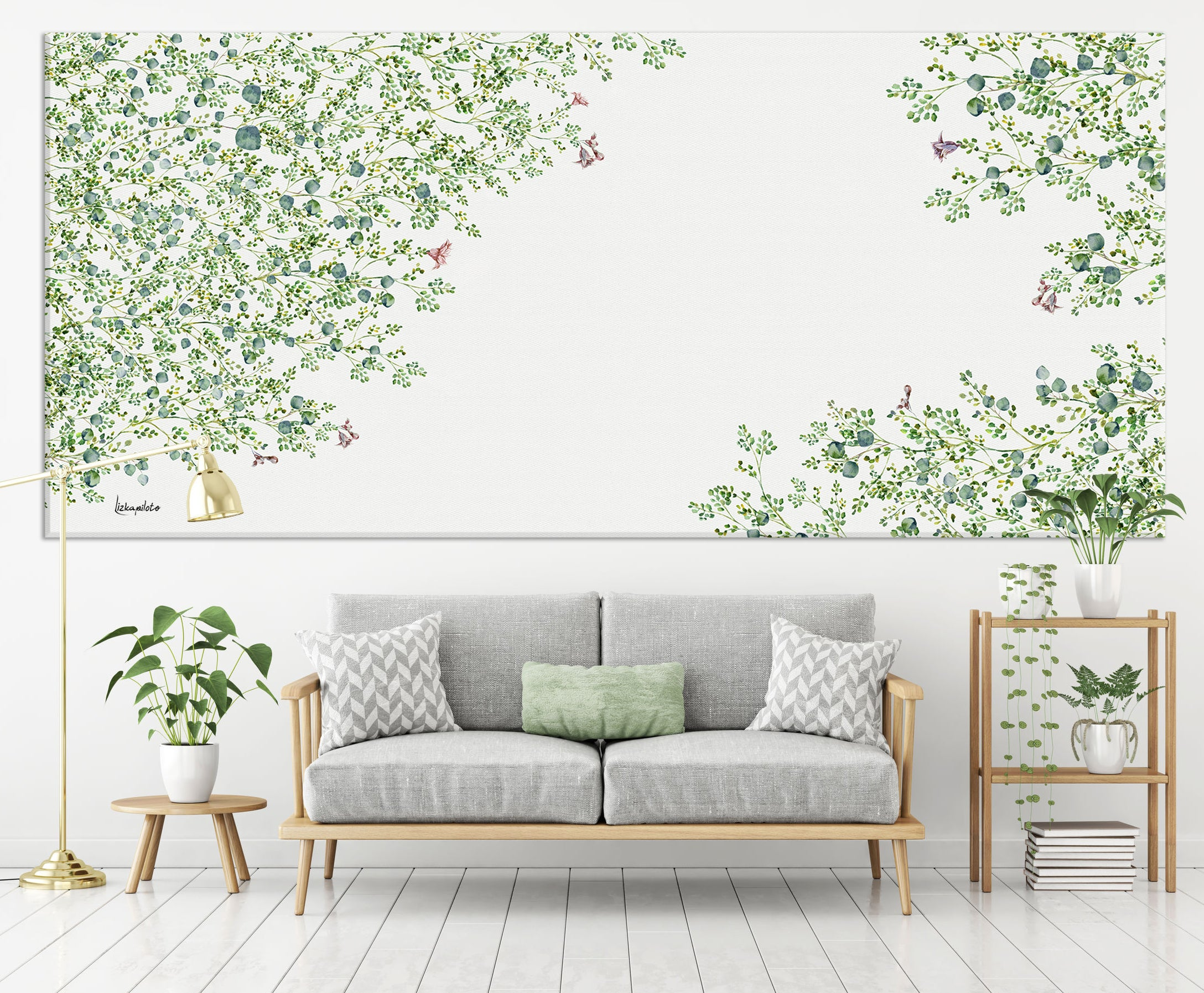 Panoramic wall art of green leaves painting, above gray sofa