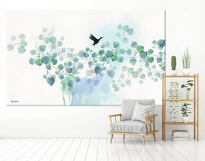 Turquoise watercolor painting of leaves and black bird - Liz Kapiloto Art & Design Large canvas painting of turquoise leaves, hanging on a white wall