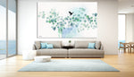 Nordic wall art of turquoise watercolor leaves, hanged in a modern living room above the sofa