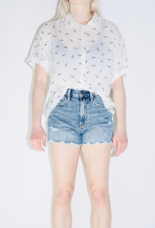 Clear Glasses Print Top In Off White