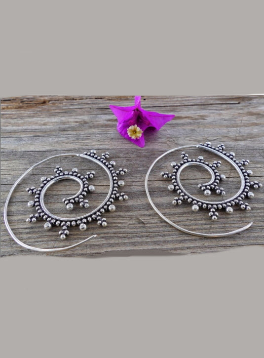 Delicate silver spiral hoop earrings