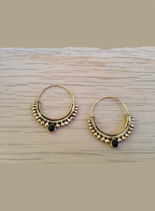 Brass hoop earrings with garnet setting