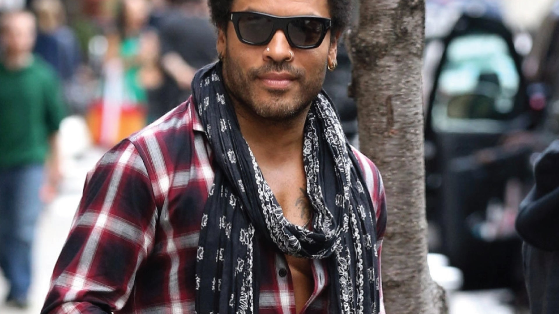 Lenny Kravitz in a red flannel