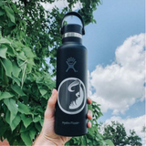HYDRO FLASK WITH MUSKOX STICKER ON IT