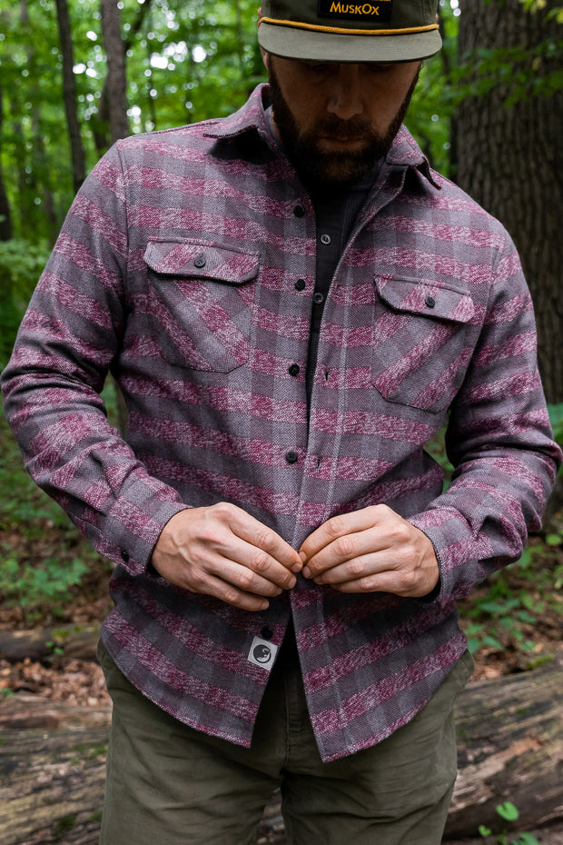 MuskOx Clothing The Grand Flannel, Burgundy, Red. 100% Cotton, Durable Flannel Shirt. Our flannels are made of a heavy duty cotton twill with a soft brushed finish so you can be prepared for any adventure without sacrificing comfort. Since we want you to be built for every occasion, we've included two secure chest pockets for you to bring your vitals along.
