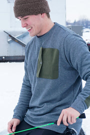 The MuskOx crewneck will keep you insulated and ready for anything. Built with your everyday adventure in mind, it's constructed with a classic but modern design that offers versatility and comfort. Our waxed canvas elbow patches provide durability when you have to get your hands dirty. We've also included a handy locker-loop for when hangers aren't an option.