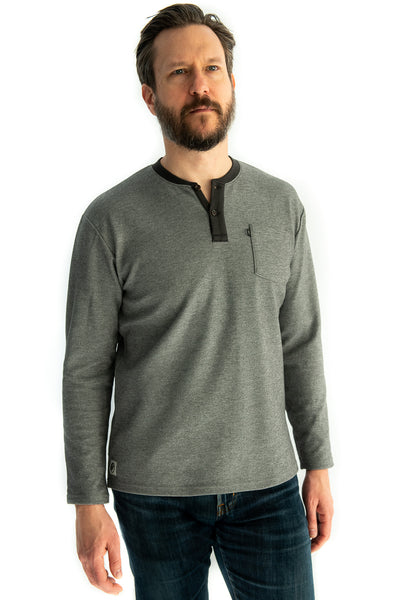Long sleeve henley in Charcoal. Our Trek Henley offers a relaxed and warm fit when you're getting lost in adventure. We constructed this outdoor henley with sturdy birdseye pique fabric so you don't have sacrifice comfort for durability. This henley comes with a chest pocket and bungee sunglasses loop.