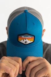 The Mountain Trucker Hat is our 100% American-made hat. It's a rugged look works with any outfit whether you're visiting a national park or on the way to a tailgate. Designed with our mountain range patch, chill out with the structured fit of this snapback trucker hat. The Mountain Trucker Hat is our 100% American-made hat. It's a rugged look works with any outfit whether you're visiting a national park or on the way to a tailgate. Designed with our mountain range patch, chill out with the structured fit