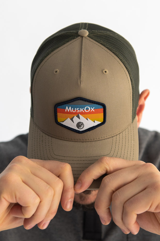 The Mountain Trucker Hat is our 100% American-made hat. It's a rugged look works with any outfit whether you're visiting a national park or on the way to a tailgate. Designed with our mountain range patch, chill out with the structured fit of this snapback trucker hat.