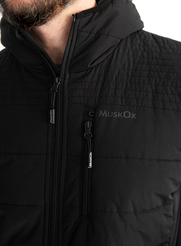 "The Wrangell Puffer Jacket takes its name from the Wrangell Mountains in Alaska and is the namesake jacket of Wrangell the muskox, resident ""boss-ox"" at the Alaska Wildlife Conservation Center. This jacket is packed full of poly insulation giving you the perfect amount of warmth, lab tested for outdoor activity down to -1°F. Not only does this jacket give you warmth and mobility, it is equipped with performance features like our signature bungee sunglasses loop."