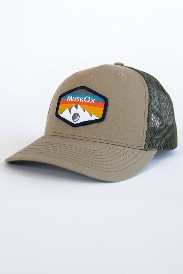 The Mountain Trucker Hat is our 100% American-made hat. It's a rugged look works with any outfit whether you're visiting a national park or on the way to a tailgate. Designed with our mountain range patch, chill out with the structured fit of this snapback trucker hat. This trucker hat is made in the USA.