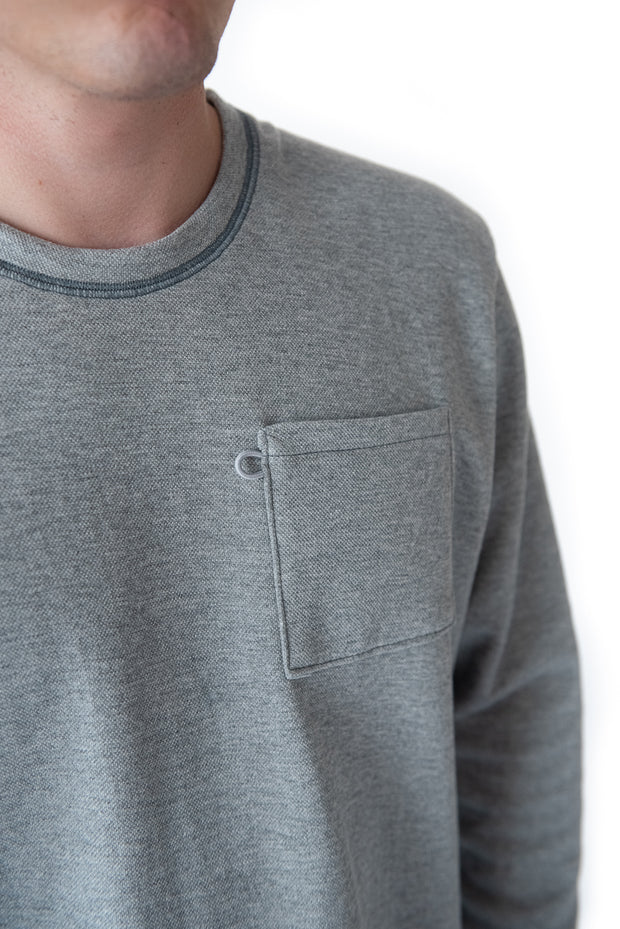 Crew Sweatshirt in Heathered Grey. The Holden Crew is our 100% Made In America, Detroit-made sweatshirt. It has relaxed fit and traditional cut that embodies classic Americana sportswear. It comes equipped with a bungee sunglass loop, flatlock stitching, and chest pocket. The Holden Crew is our 100% American-made sweatshirt.