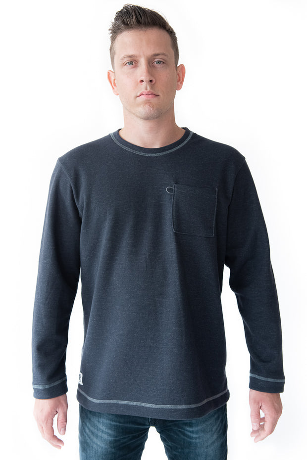 Crew Sweatshirt in Slate Grey. The Holden Crew is our 100% Made In America, Detroit-made sweatshirt. It has relaxed fit and traditional cut that embodies classic Americana sportswear. It comes equipped with a bungee sunglass loop, flatlock stitching, and chest pocket. The Holden Crew is our 100% American-made sweatshirt.