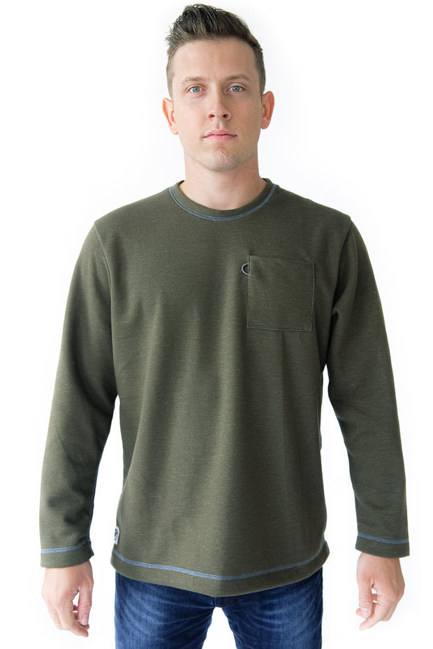Crew Sweatshirt in Olive Green. The Holden Crew is our 100% Made In America, Detroit-made sweatshirt. It has relaxed fit and traditional cut that embodies classic Americana sportswear. It comes equipped with a bungee sunglass loop, flatlock stitching, and chest pocket. The Holden Crew is our 100% American-made sweatshirt.