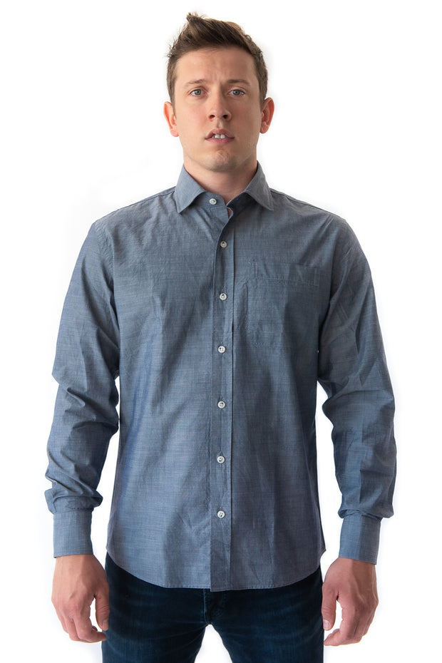Chambray Shirt by MuskOx Men's Outdoor Apparel. The Beckett Chambray is a perfect button down for hot summer days transitioning into cooler evenings. The chambray fabric gives the shirt a unique and stylish color effect while the 100% cotton build keeps this shirt light and soft. Depart for your day in this long sleeve and never worry about the need to change before your evening out.