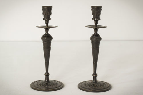 A Classic Pair of Bronze Candlesticks