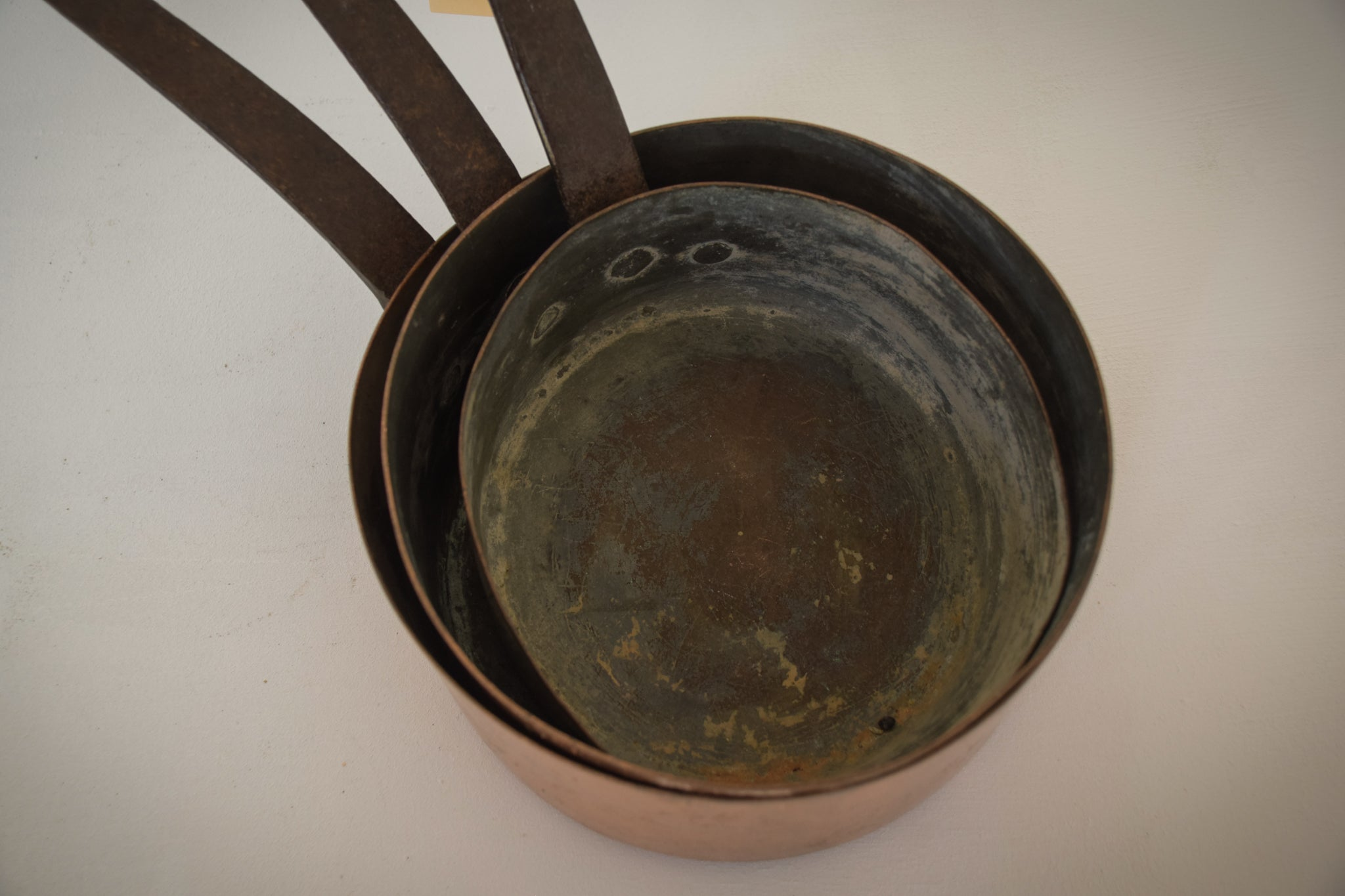 Three Copper and iron handle Saucepans