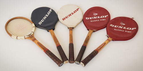 Five Mid-Century Dunlop Tennis Rackets with Four Cases