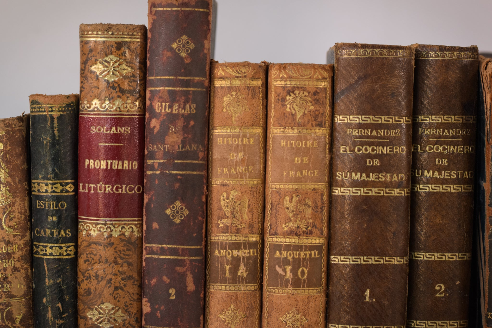 A decorative mixed collection of 44 antique books