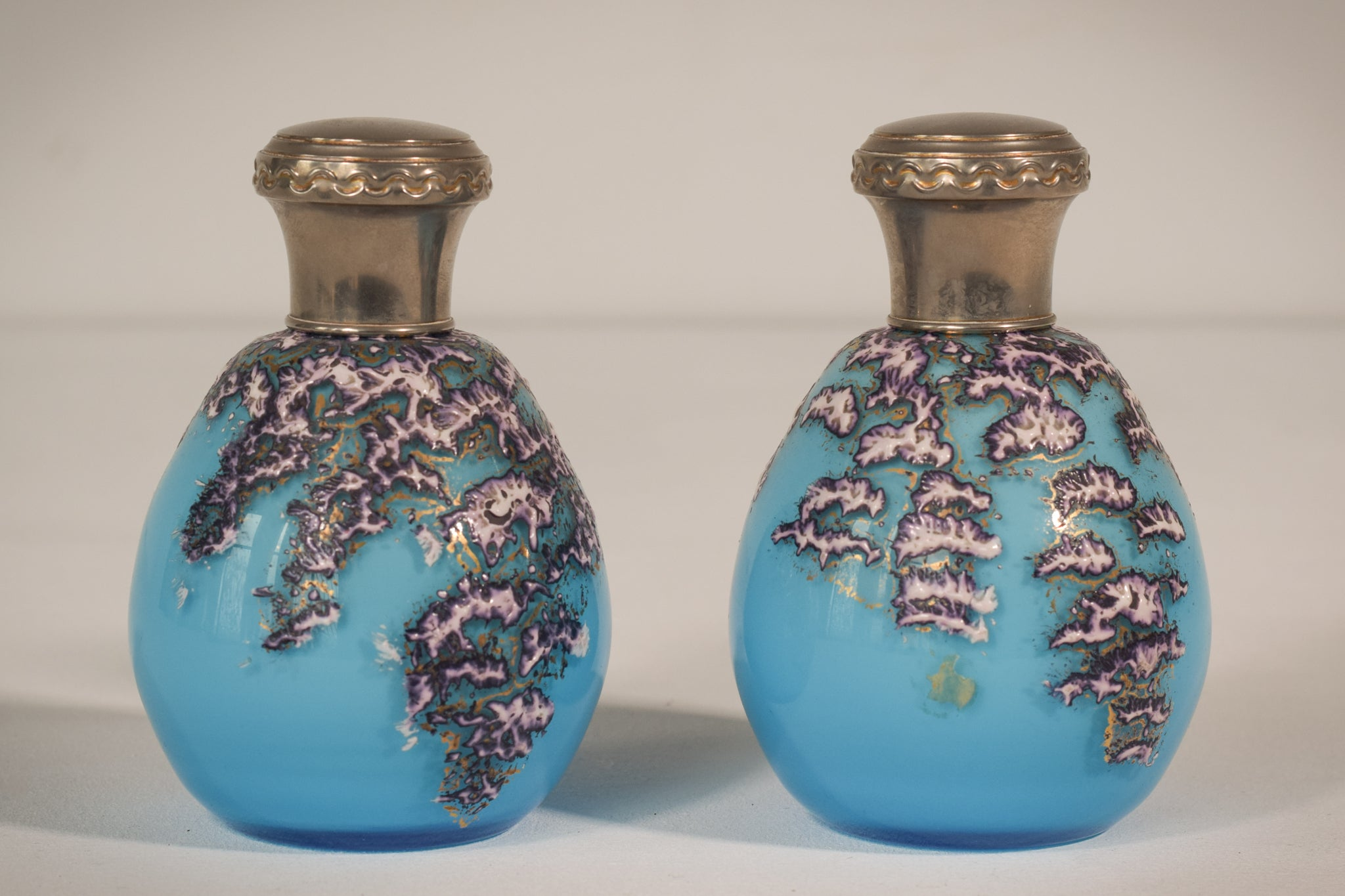 Pair of enamelled glass perfume bottles