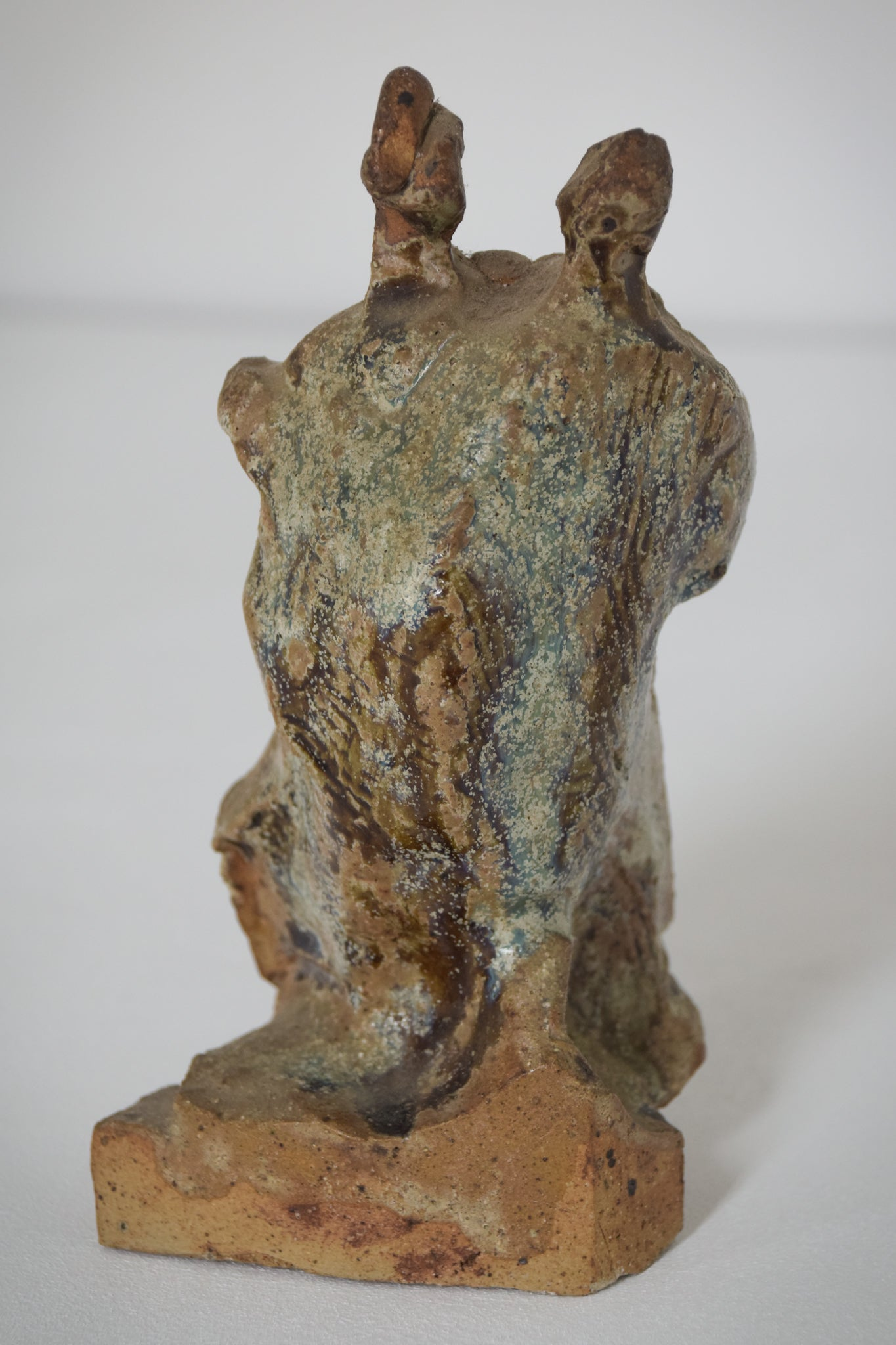 Sculpture of a Figure Playing an Instrument in an Abstract Style_Back 2