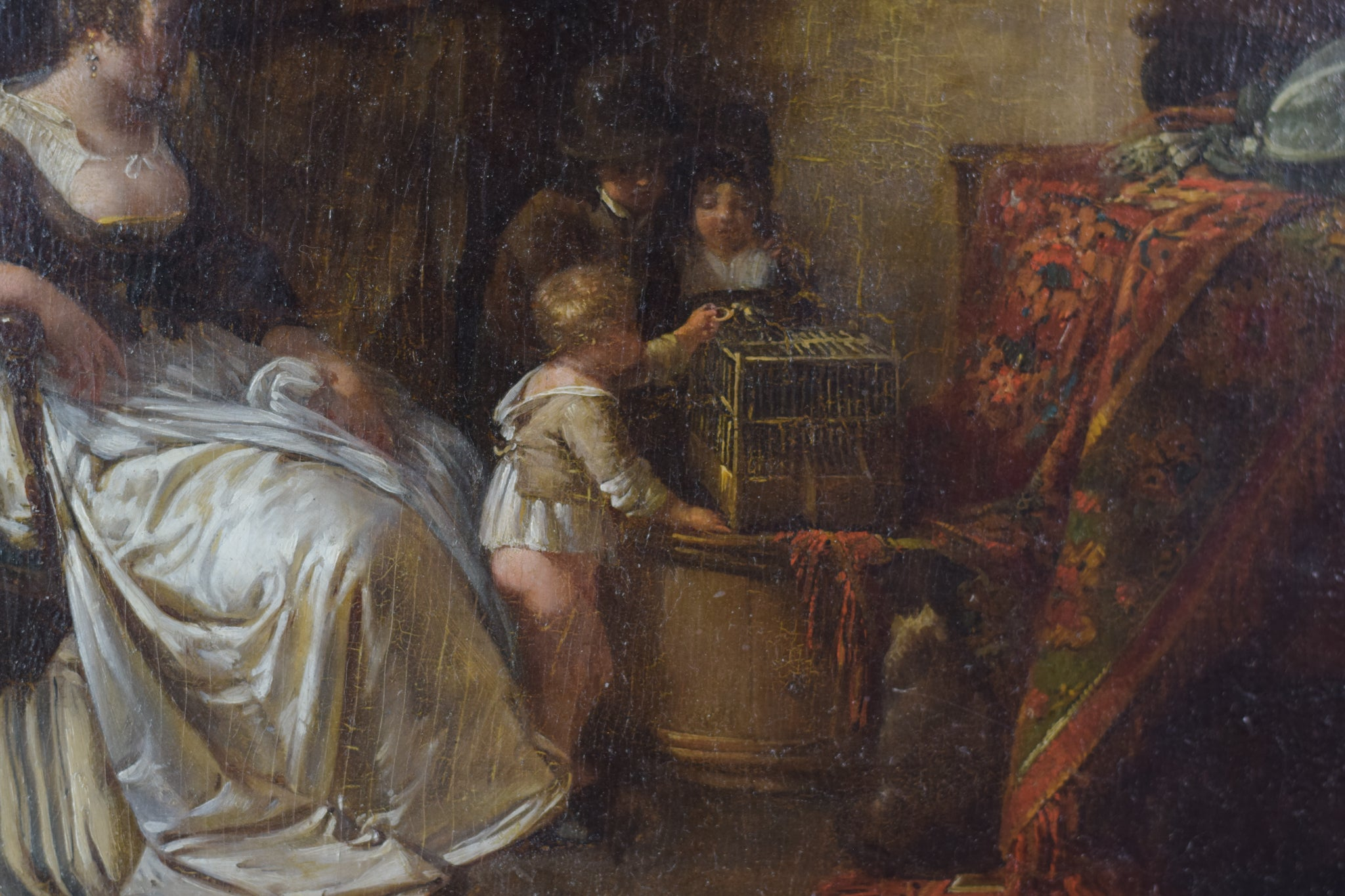 Late 18th Century Domestic scene with children feeding a bird in a cage with mother and maid_Detail