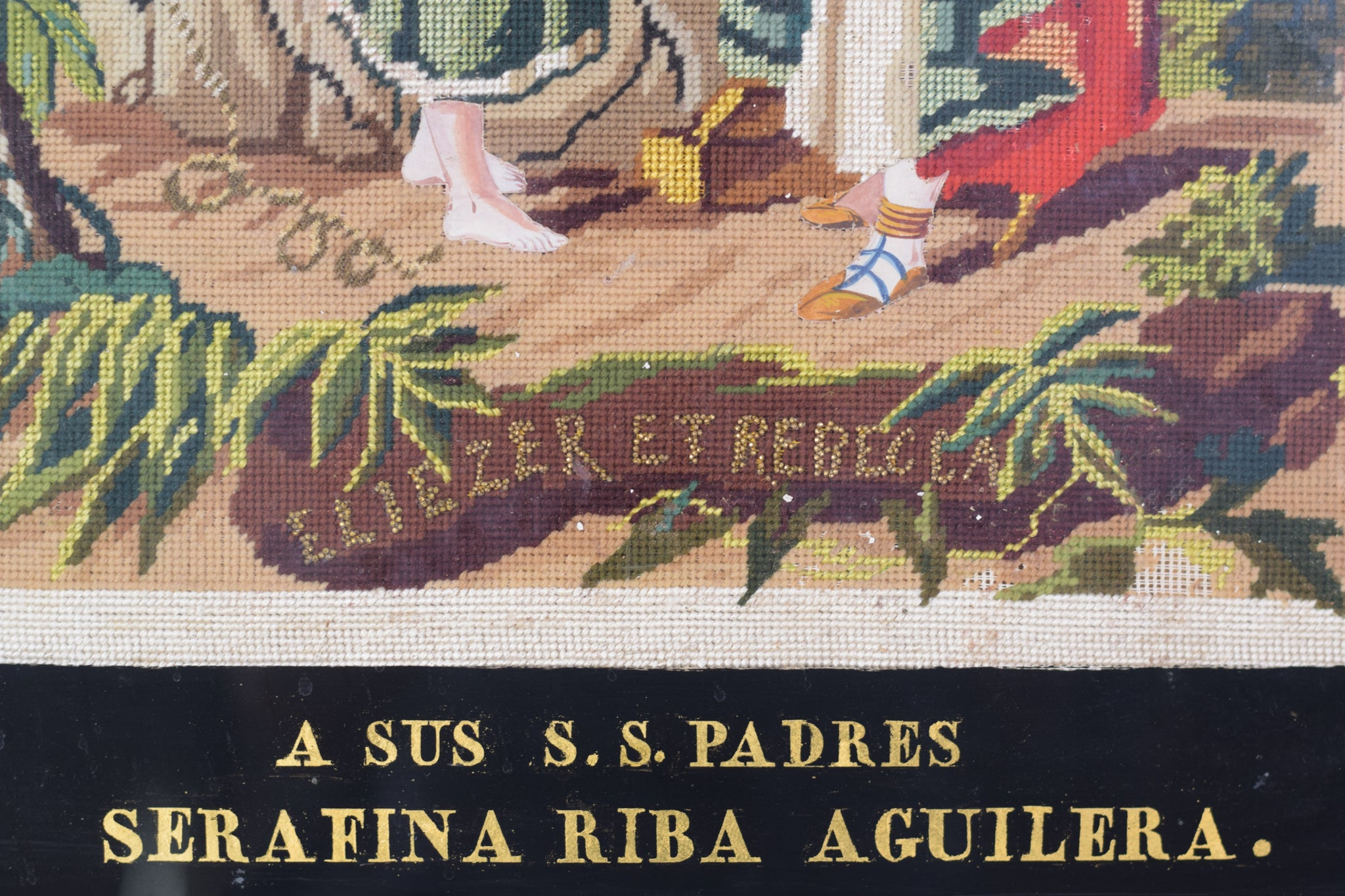 Framed embroidery 'Rebecca and Elezier at the Well'_Inscription