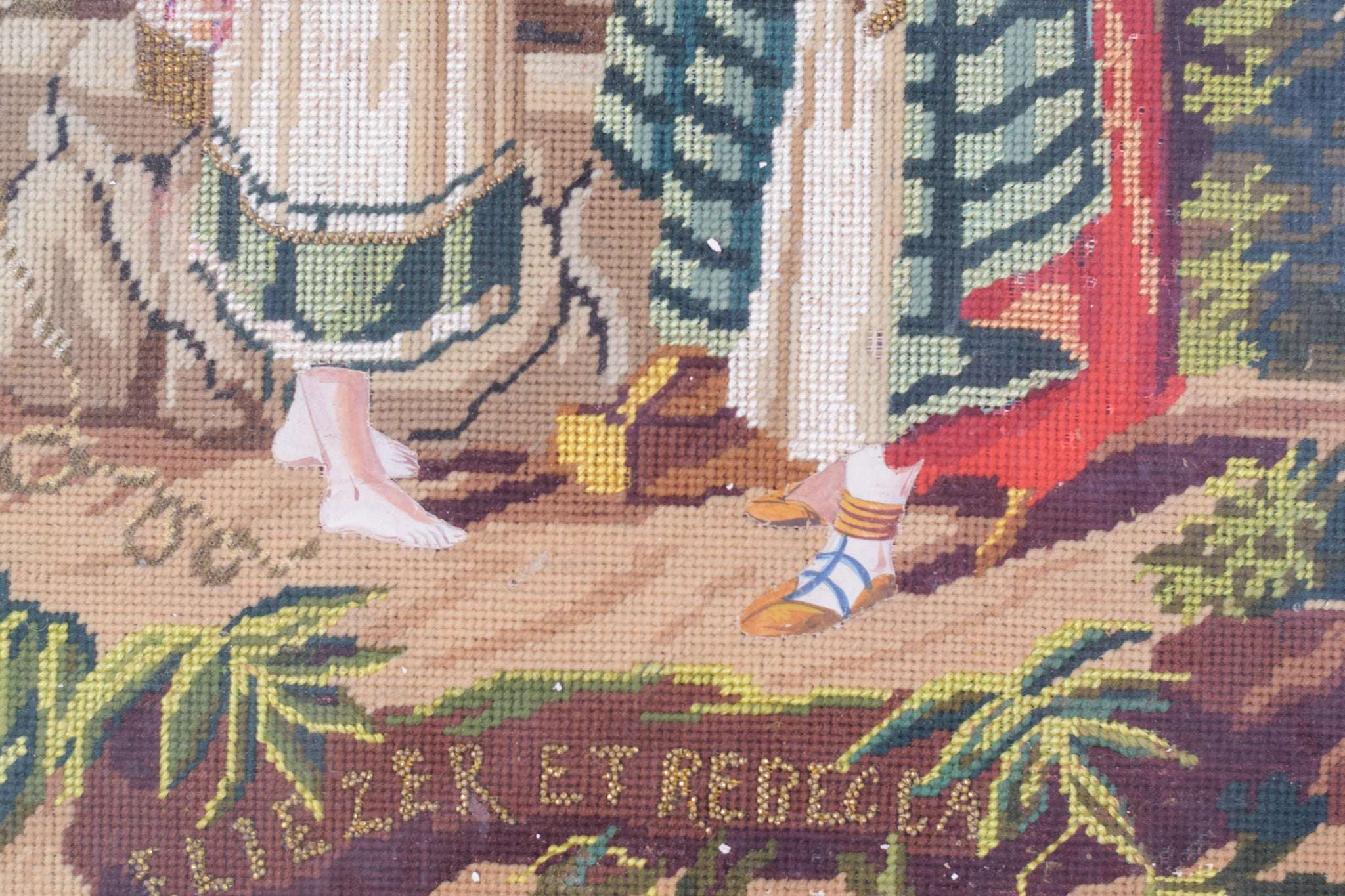 Framed embroidery 'Rebecca and Elezier at the Well'_Title