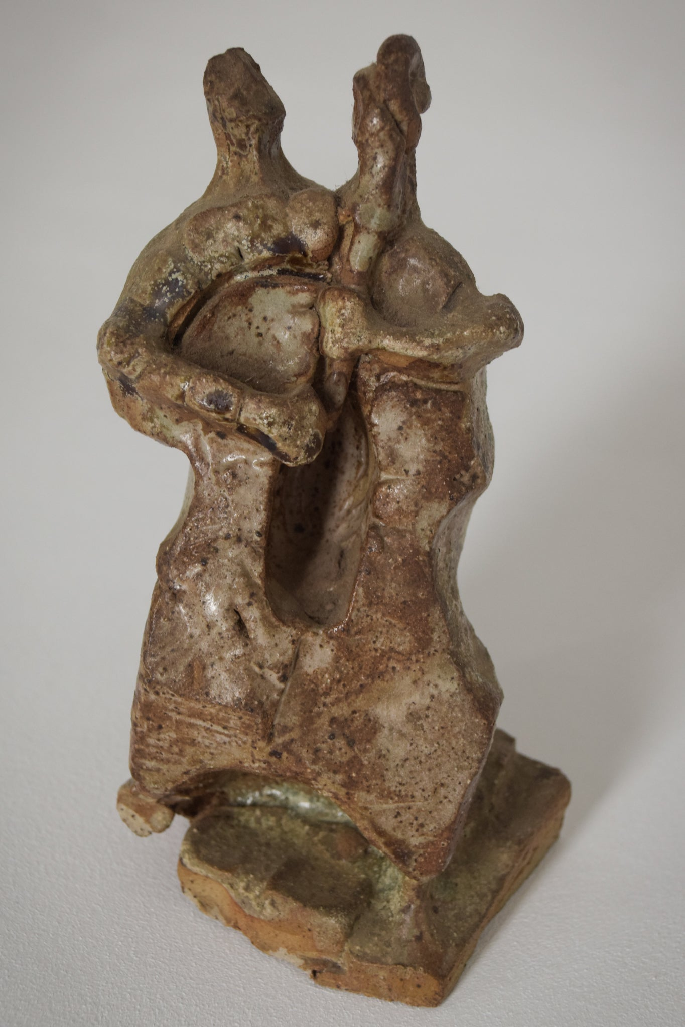 Sculpture of a Figure Playing an Instrument in an Abstract Style