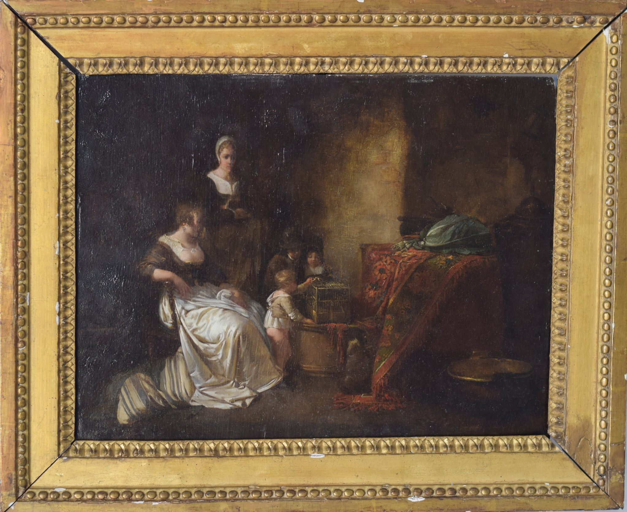 Late 18th Century Domestic scene with children feeding a bird in a cage with mother and maid_Framed