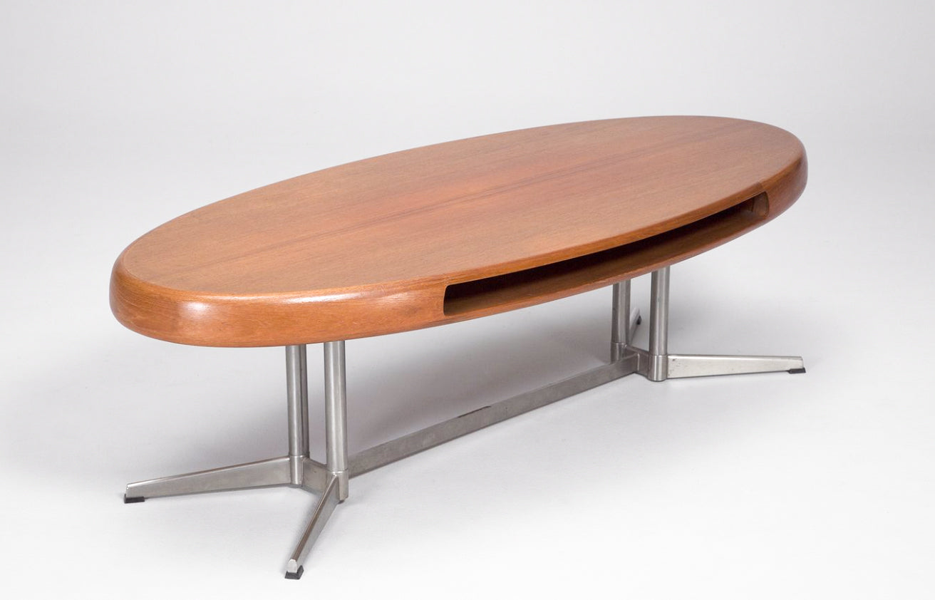 This stylish, wooden, mid-century coffee table is by prominent 20th century Danish designer Johannes Andersen. Andersen developed his own studio in the 1930s and shot to fame as the appreciation for Scandinavian design peaked in the 1950s. This is a true collector's piece as Andersen was especially celebrated for his coffee tables. This item was designed for the Swedish manufacturer Trensum.