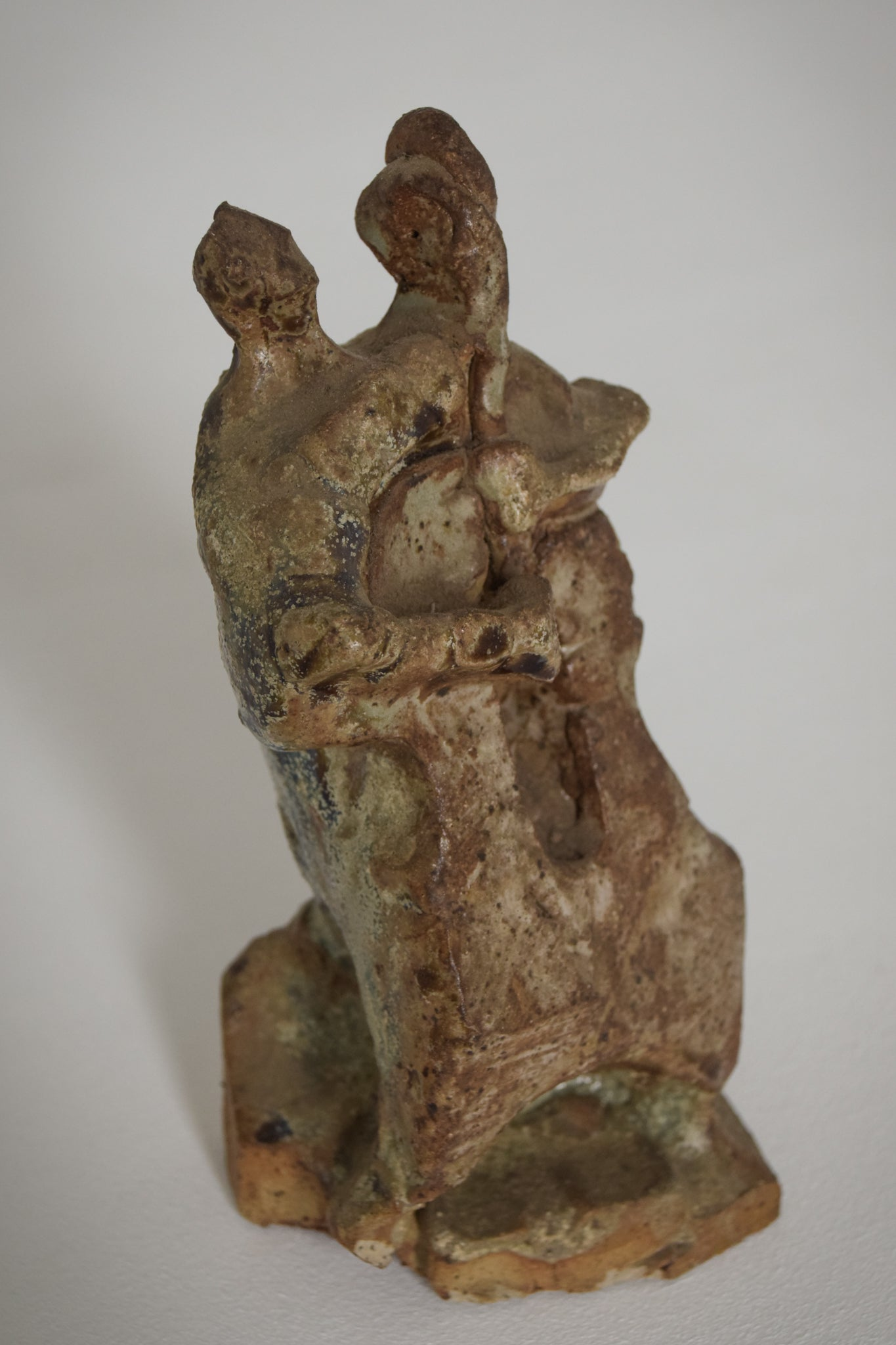 Sculpture of a Figure Playing an Instrument in an Abstract Style_3