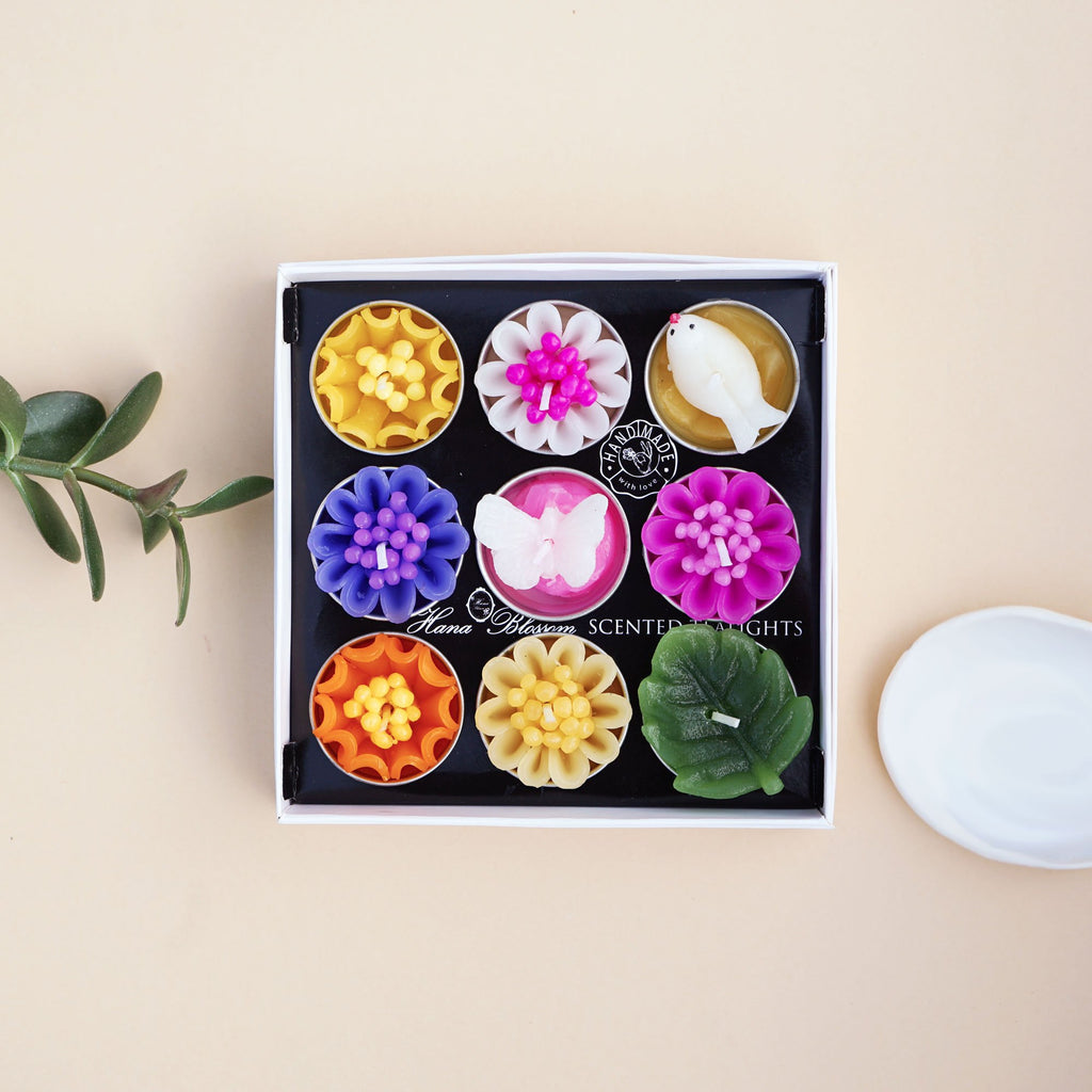 Handmade and fair trade flower scented tea lights in assorted bird butterfly and flower design.