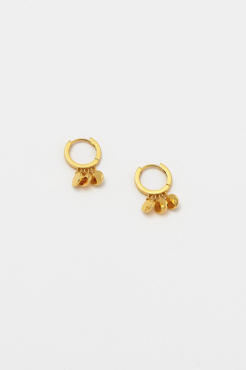 ESTELLA BARTLETT DISC CHARM HUGGIE EARRINGS