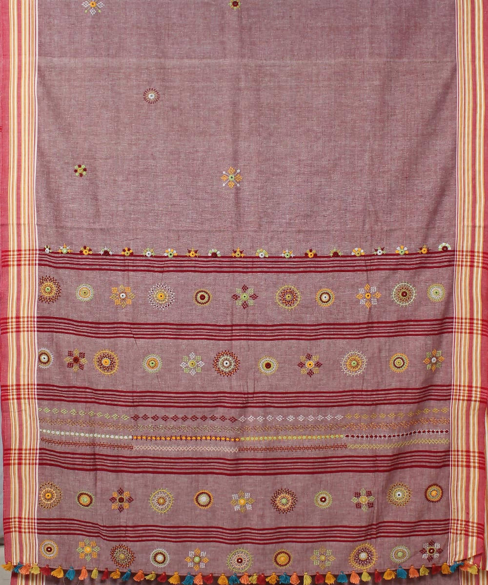 red hued white hand embroidery cotton saree