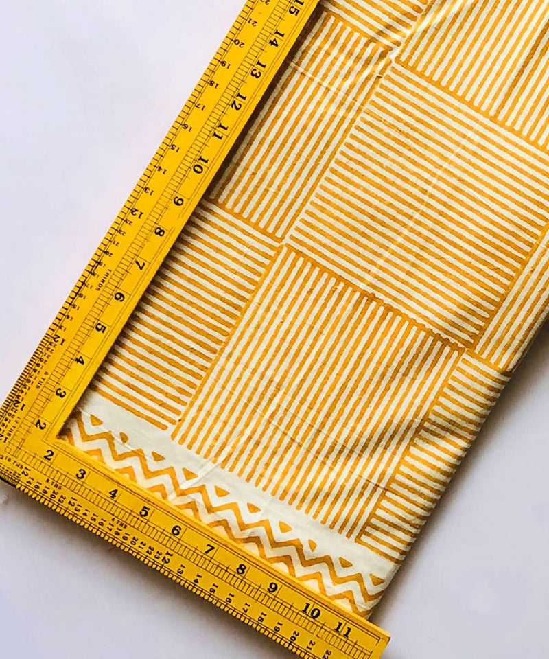 Mustard stripes print on white handspun handloom cotton fabric