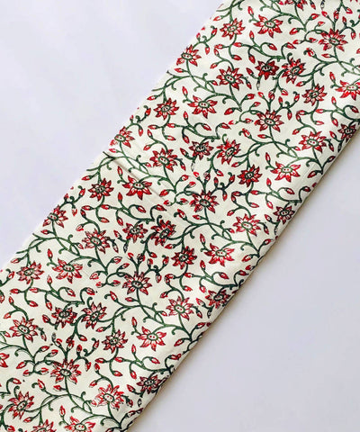 Red and Green floral prints on white handspun handwoven cotton fabric