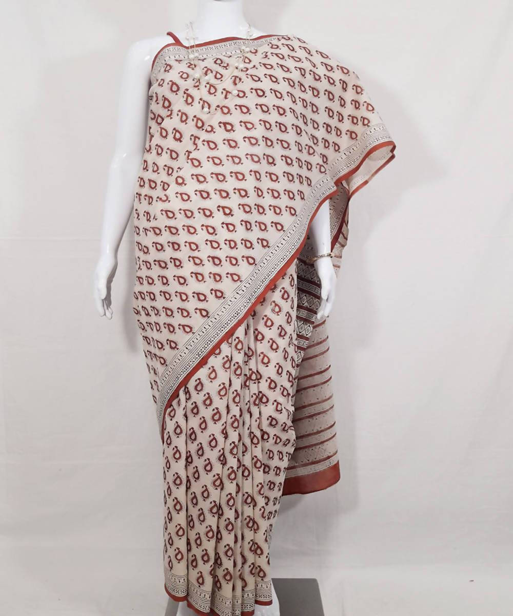 Beige red hand printed dabu print cotton saree