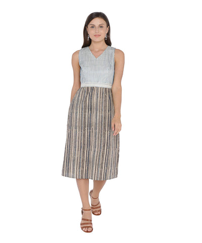 Sleeveless calf length cotton dress with a fitted body and straight skirt